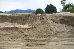 Sand stock and storage on rained day. Royalty Free Stock Photo