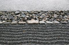 Sand and stone. Zen composition with stack of grey stone over sand Royalty Free Stock Images