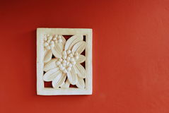 Sand stone Bas-relief of frangipani flower Stock Photography