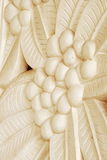 Sand stone Bas-relief of frangipani flower Stock Photo