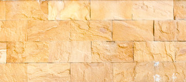 Sand stone brick wall,texture background Royalty Free Stock Photos