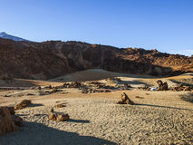 Sand and stone desert. Volcanic landscape - stone - sand - hills - blue sky Stock Photos