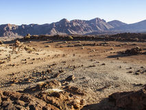 Sand and stone desert. Volcanic landscape - stone - sand - hills - blue sky - bright daylight Stock Photo