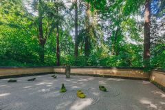 Sand and Stone Garden among trees at Portland Japanese Garden, Portland, USA. View of Sand and Stone Garden among trees at Portland Japanese Garden, Portland stock images
