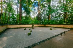 Sand and Stone Garden among trees at Portland Japanese Garden, Portland, USA. View of Sand and Stone Garden among trees at Portland Japanese Garden, Portland royalty free stock photography