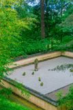 Sand and Stone Garden among trees at Portland Japanese Garden, Portland, USA. View of Sand and Stone Garden among trees at Portland Japanese Garden, Portland royalty free stock photos