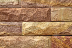 Sand stone wall surface, background of decorate Royalty Free Stock Photos