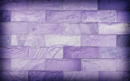 Sand stone wall texture and ackground of decorate,. Purple color Royalty Free Stock Image