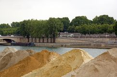 Sand stored on a dock of the Seine in Paris. France Royalty Free Stock Photos