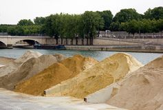 Sand stored on a dock of the Seine in Paris. France Stock Images