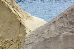 Sand stored on a dock of the Seine in Paris. France Royalty Free Stock Photo