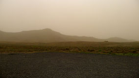 Sand storm in Fuerteventura. A storm of sand that darkens the sky at fuerteventura spain canary islands stock image