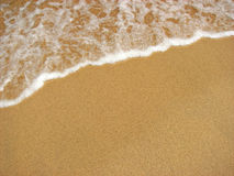 Sand-Strand-Wasser-Brandung Stockbild