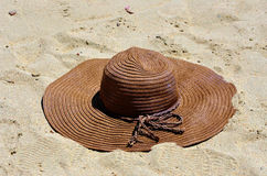 Sand and straw hat Stock Photos