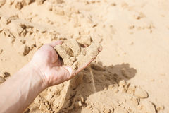 Sand strewing from hand Royalty Free Stock Photo