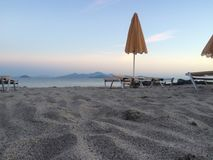 Sand Sun Lounger parasol royalty free stock photo