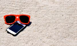 In the Sand-Sunglasses iPod iPhone. In the Sand - Sunglasses iPod iPhone Stock Images