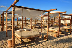 Sand suny beach with suspended beds Royalty Free Stock Photo