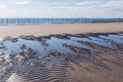 Sand surface on the beach with sea. Royalty Free Stock Images