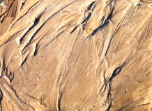 Sand surface with the relief formed by water currents Royalty Free Stock Photography