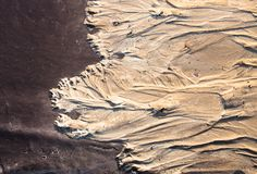 Sand surface with the relief formed by water currents Stock Photo