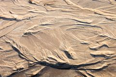 Sand surface with the relief formed by water currents Stock Photos