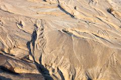 Sand surface with the relief formed by water currents Royalty Free Stock Images