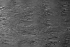 Sand surface with unusual patterns. Water made pictures on a sand while low tide. Black and white. Top view stock images