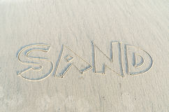 SAND text on sand Stock Photography
