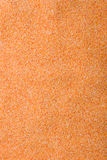 Sand texture. Bright orange sand texture background Stock Images