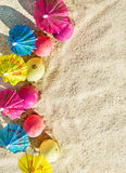 Sand texture (background) with colorful easter eggs with umbrellas on the beach. Royalty Free Stock Image