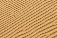 Sand texture.Dented wave of the blow of the wind. Royalty Free Stock Photos