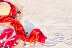 Sand texture with flip flop sandals, hat, pareos (sarong). Stock Image