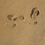 Sand texture with foot steps Royalty Free Stock Photos