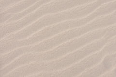 Sand texture. This is sand from Greek beach after strong wind with undisturbed wind compressions stock photos