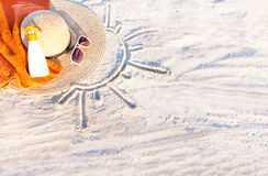 Sand texture with hat, towel, sunscreen and sunglasses. Sand texture (background) with hat, towel, sunscreen (suntan lotion, suncream) and sunglasses on the a stock photography