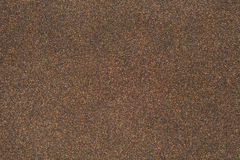 Sand texture of rubberoid, asphalt macro background Royalty Free Stock Image