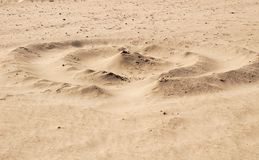 Sand texture and spiral shaped dune on the beach. In the morning stock photography