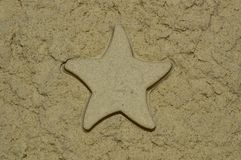 Sand texture with a star made of sand. Close up royalty free stock photos