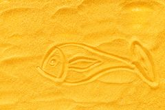 Sand texure and fish picture for design of blog top view mock-up.  stock photo