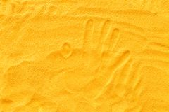 Sand texure and hand picture for design of blog top view.  royalty free stock photo
