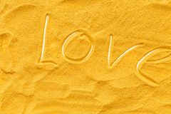 Sand texure and love text for design of blog top view.  stock images