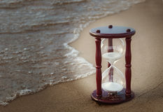 Sand timer on beach Royalty Free Stock Photography