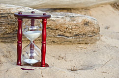 Sand timer in sand Royalty Free Stock Photos