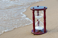 Sand timer on the seashore Royalty Free Stock Images