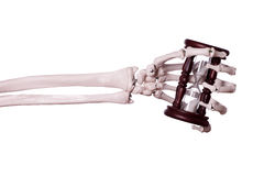 Sand timer in skeleton hand Stock Image