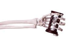 Sand timer in skeleton hand stock image