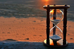 Sand timer with sunset glow Royalty Free Stock Photo