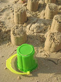 Sand towers. And the toy bucket used to build them Stock Photo