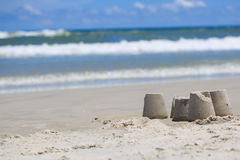 Sand towers on the calm beach. A couple sand towers on the beautiful beach Royalty Free Stock Photos